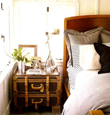 bedside table suitcase bed