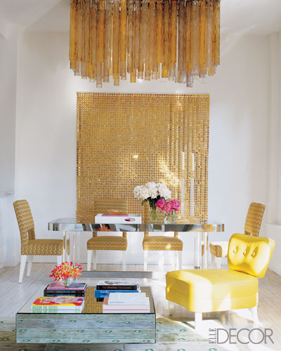 gold dining room Elle Decor chandelier art