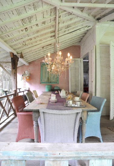 candy colored dining pink pastel outside patio chandelier