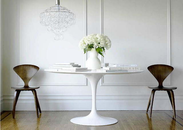 round tulip white table two chairs chandelier