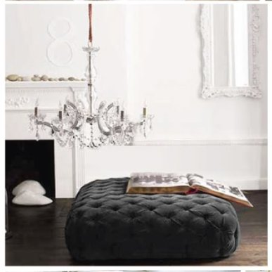 white walls tufted ottoman chandelier black