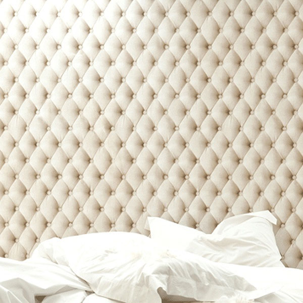 white tufted headboard bed