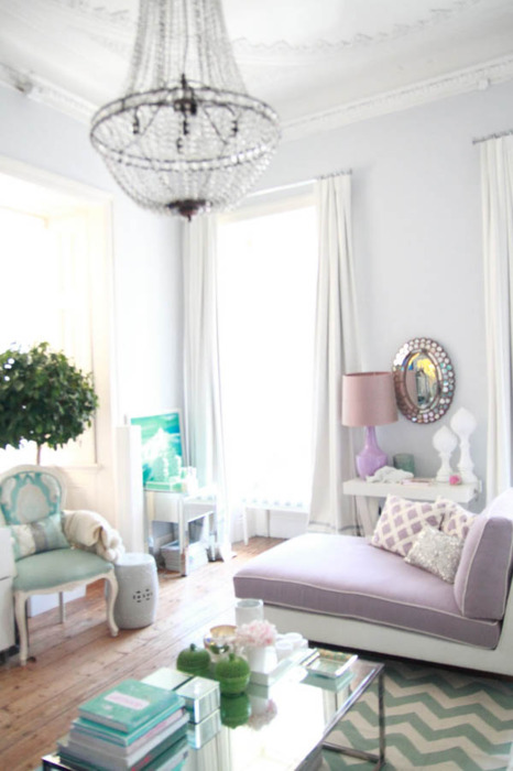 candy colored pastel pink purple green chandelier living room