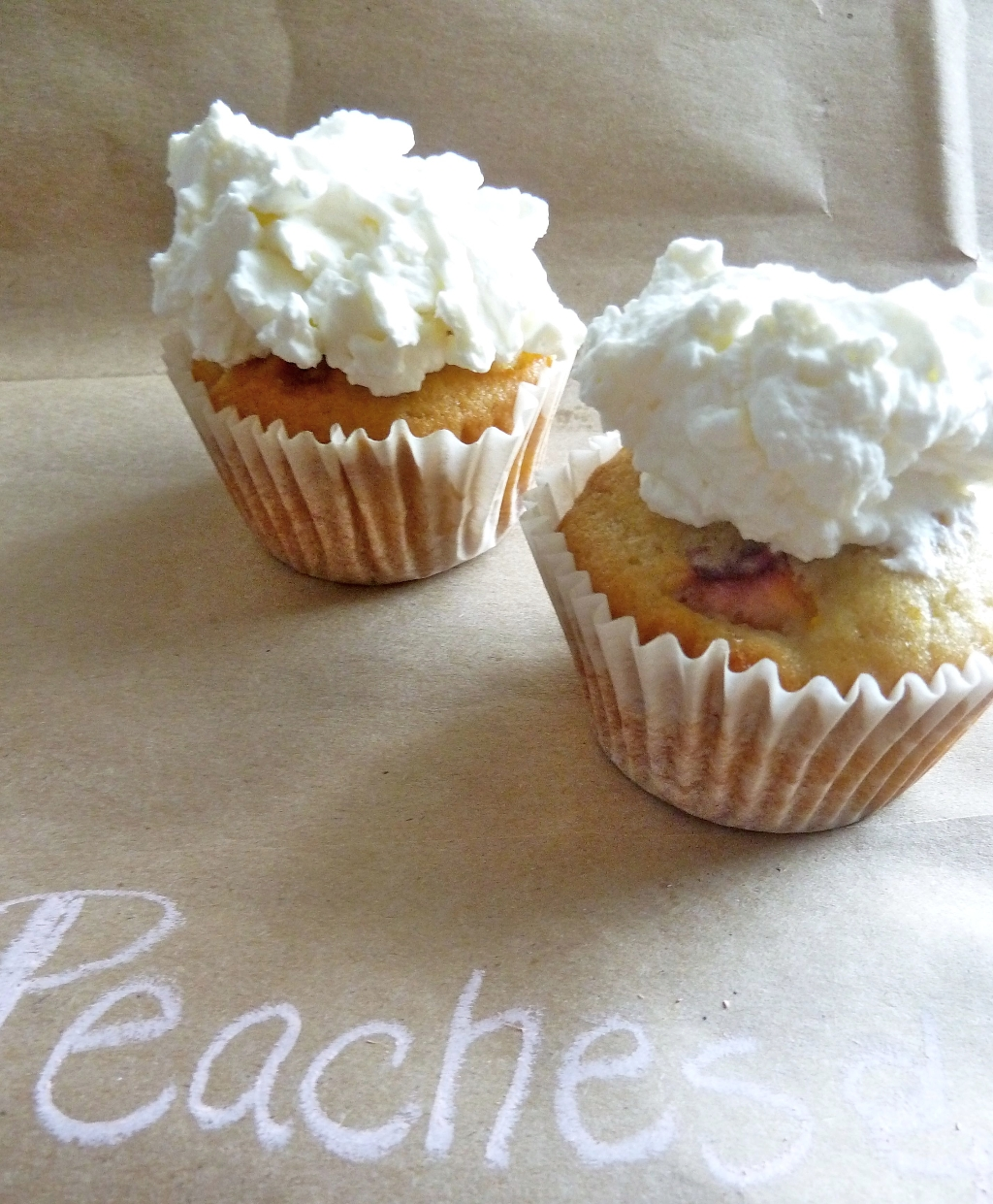 peaches and cream cupcakes with vanilla whipped cream frosting