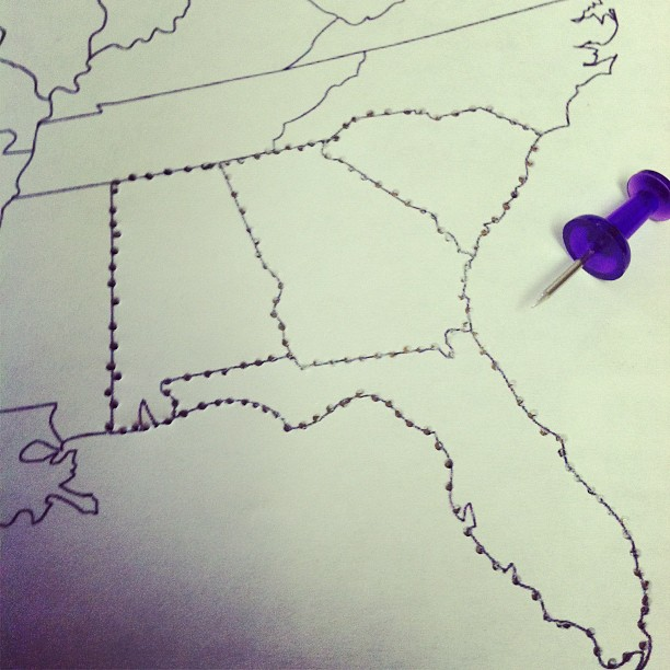 punching holes in the Election 2012 cake map