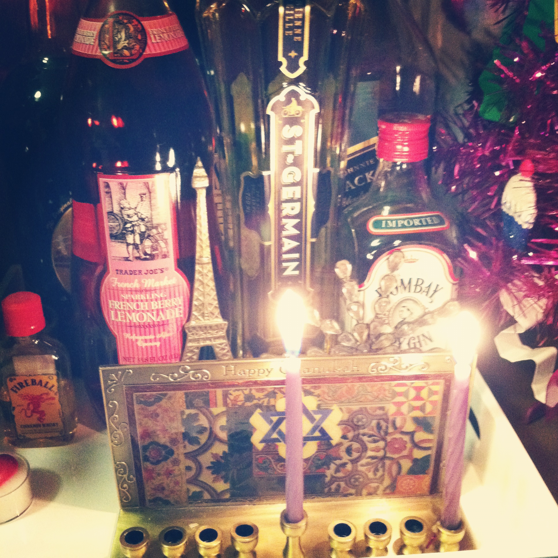menorah and pink tinsel tree bar