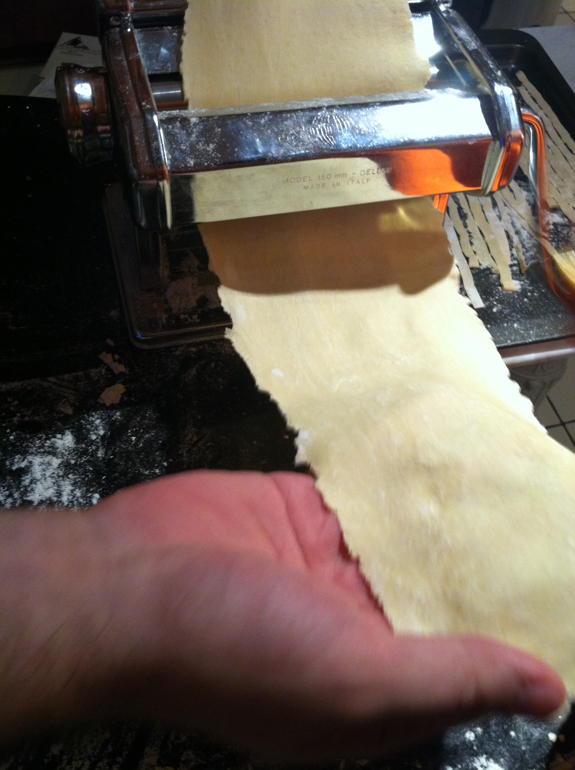 Cupcakes for Breakfast: rolling out homemade pasta on a pasta machine