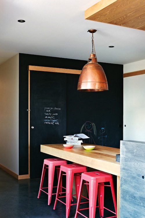 Hot pink stools in the kitchen with copper and chalkboard