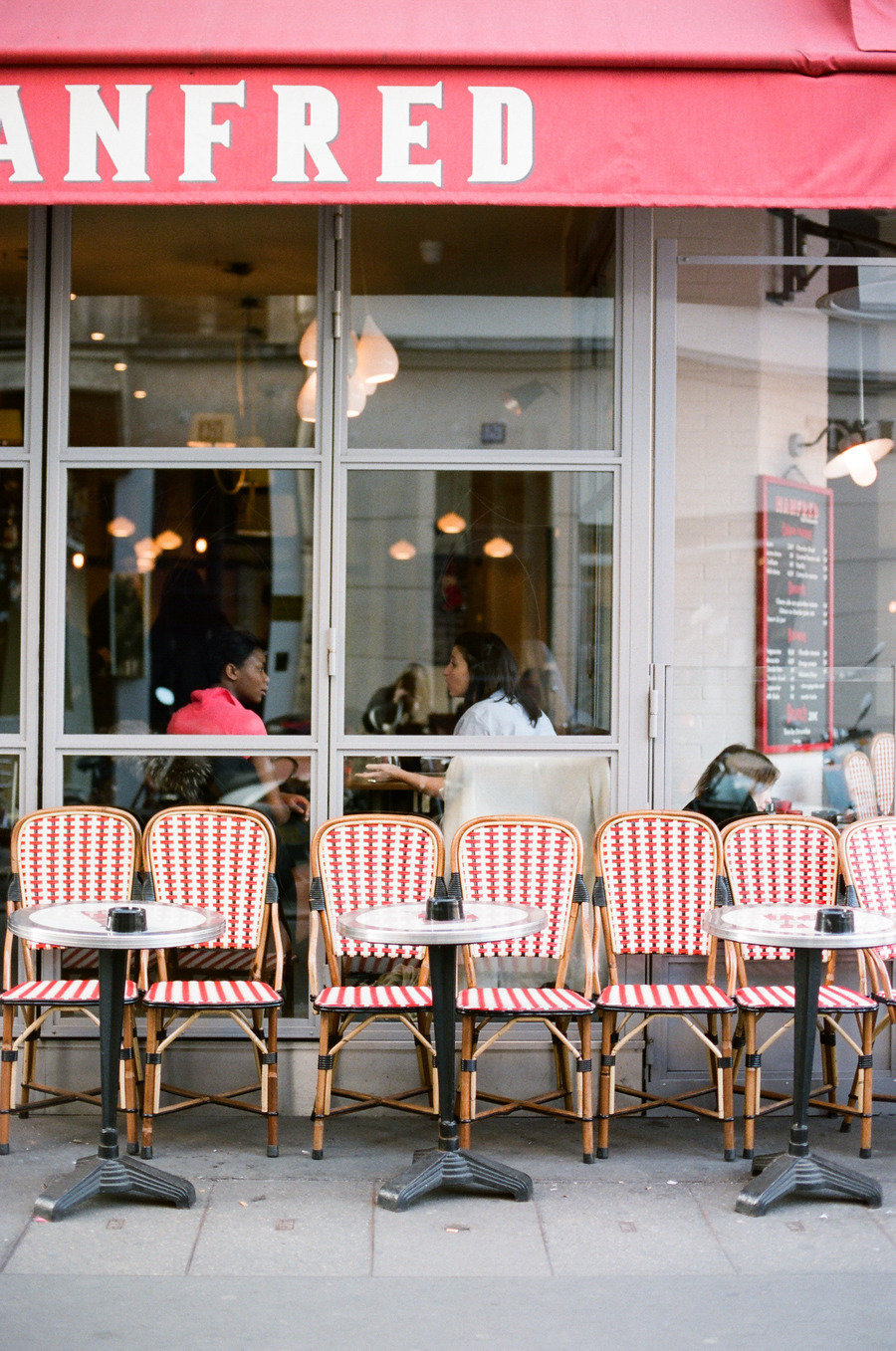 paris cafe red chairs